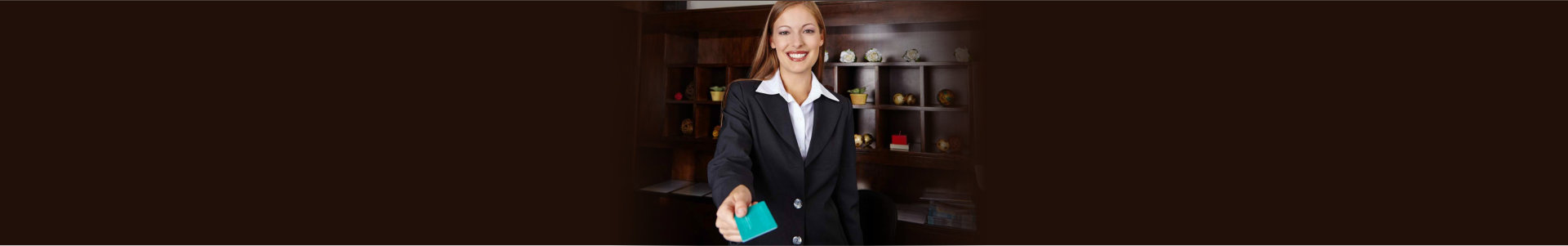 """""""happy receptionist in hotel offering key card to room"""