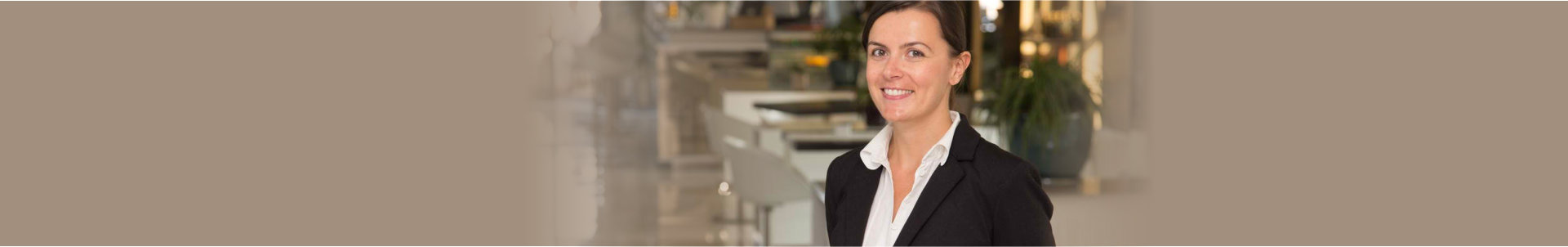 elegant and cheerful woman as receptionist